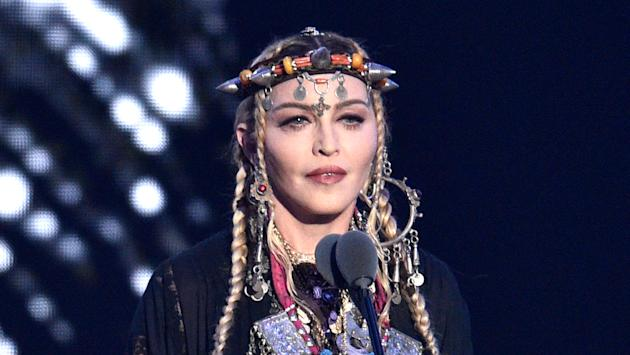 Madonna leaves Universal Music, in talks to return to Warner