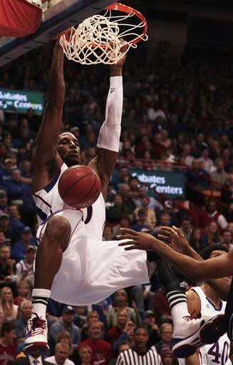 Kansas forward Thomas Robinson (0) dunks during the first half of an NCAA college basketball game against Howard in Lawrence, Kan., Thursday, Dec. 29, 2011. (AP Photo/Orlin Wagner)