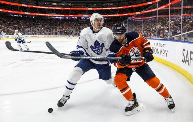 Toronto Maple Leafs' Justin Holl (3) and Edmonton Oilers' Sam Gagner (89) battle for the puck during an NHL game in Edmonton, Alta., on Dec. 14, 2019.