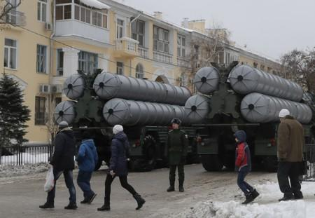 FILE PHOTO: People walk past Russian S-400 missile air defence systems before the military parade to commemorate the 75th anniversary of the battle of Stalingrad in World War Two, in Volgograd