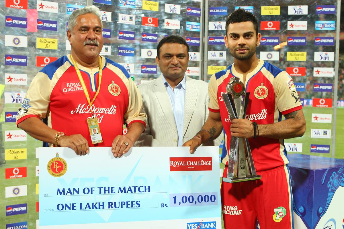 Virat Kohli receives the man of the match award during match 9 of of the Pepsi Indian Premier League between The Royal Challengers Bangalore and The Sunrisers Hyderabad held at the M. Chinnaswamy Stadium, Bengaluru on the 9th April 2013..Photo by Ron Gaunt-IPL-SPORTZPICS ..Use of this image is subject to the terms and conditions as outlined by the BCCI. These terms can be found by following this link:..https://ec.yimg.com/ec?url=http%3a%2f%2fwww.sportzpics.co.za%2fimage%2fI0000SoRagM2cIEc&t=1506379733&sig=5J4PIKW0se6CiKYTirq3QA--~D
