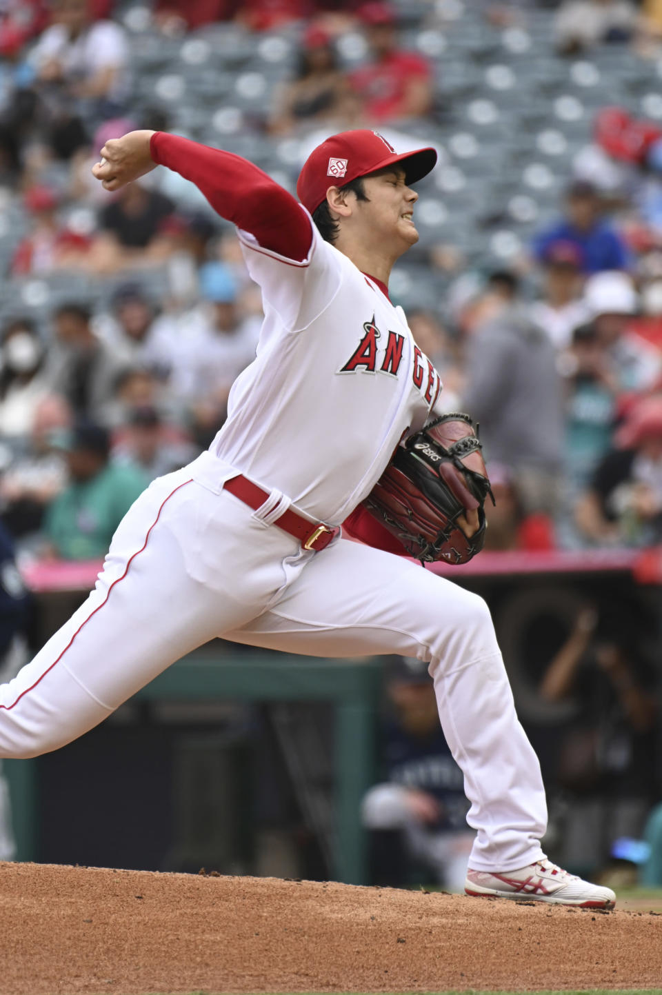Los Angeles Angels pitcher Shohei Ohtani throws to home plate during the first inning of a baseball game against the Seattle Mariners, Sunday, Sept. 26, 2021, in Anaheim, Calif. (AP Photo/Michael Owen Baker)