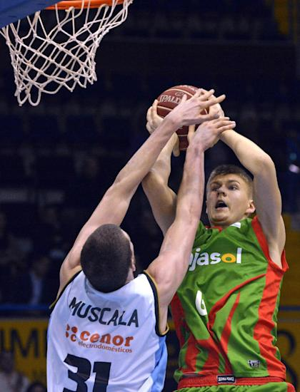 Kristaps Porzingis (right) is drawing attention for his versatility. (AP/Dario de Sevilla)