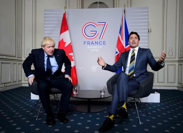 Prime Minister Justin Trudeau takes part in a bilateral meeting with U.K. Prime Minister Boris Johnson during the G7 Summit in Biarritz, France, Saturday, Aug. 24, 2019. Canada has failed to convince the U.K. to index pensions paid to British citizens living in this country. (Sean Kilpatrick/The Canadian Press - image credit)