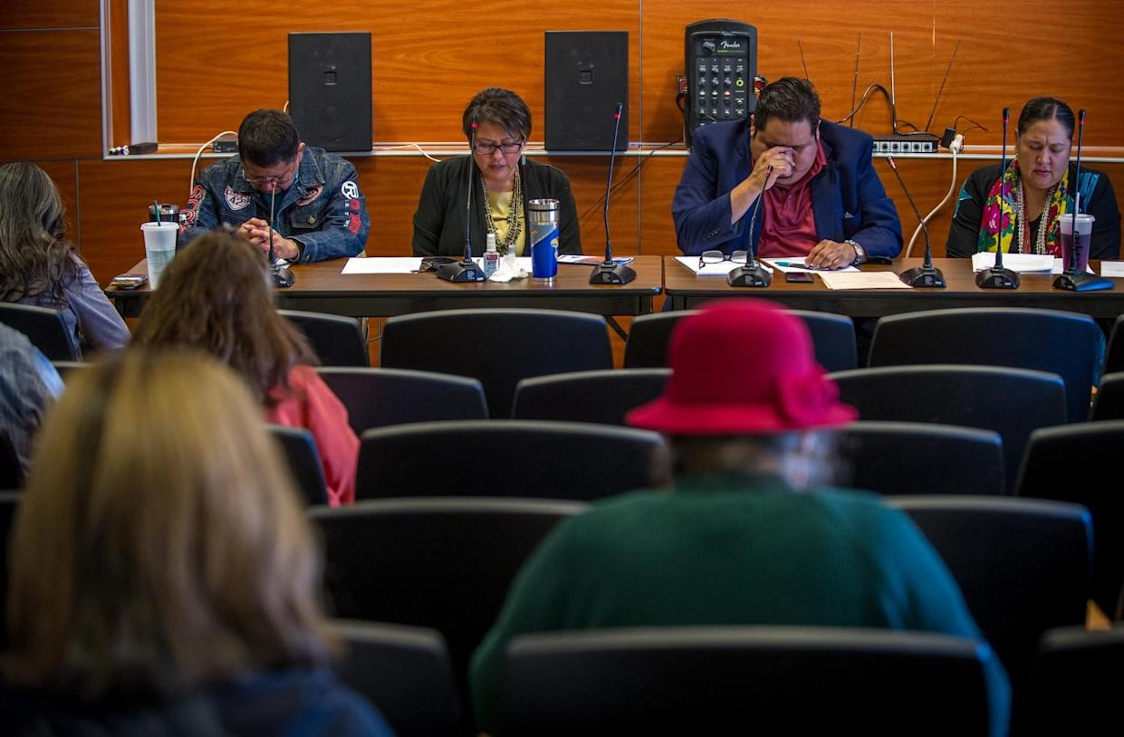 Navajo Nation council members pray at the beginning of a uranium public hearing sponsored by the Navajo Nation Council at Diné College in Shiprock, NM. (Photograph by Mary F. Calvert) (Photograph by Mary F. Calvert)