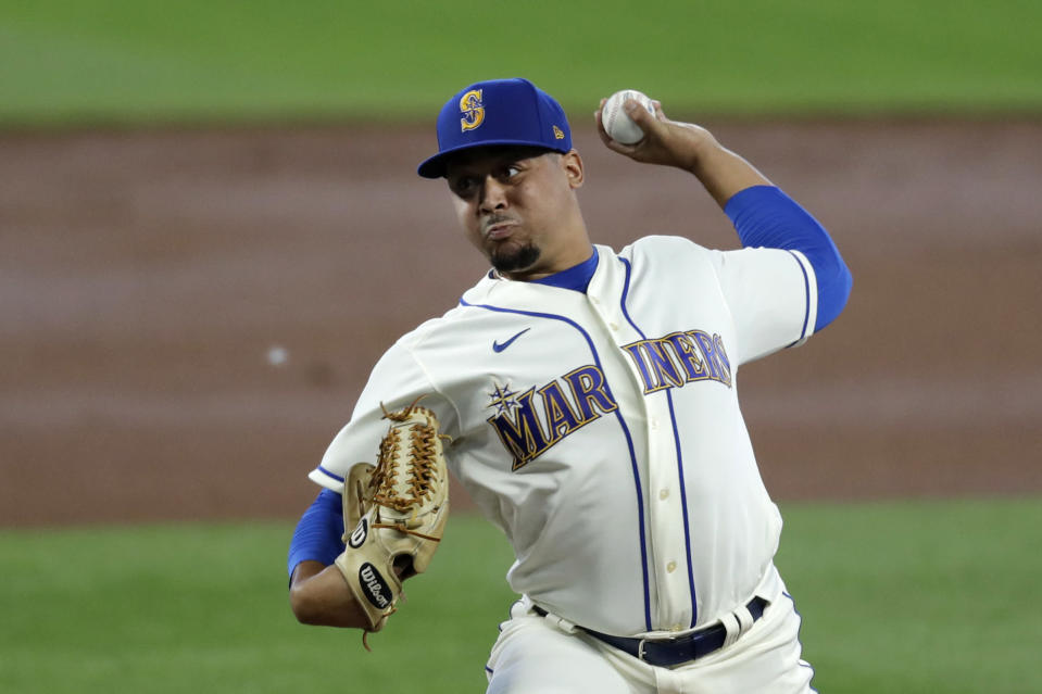 CORRECTS TO STARTING PITCHER - Seattle Mariners starting pitcher Justus Sheffield throws against the Colorado Rockies in the second inning of a baseball game Sunday, Aug. 9, 2020, in Seattle. (AP Photo/Elaine Thompson)