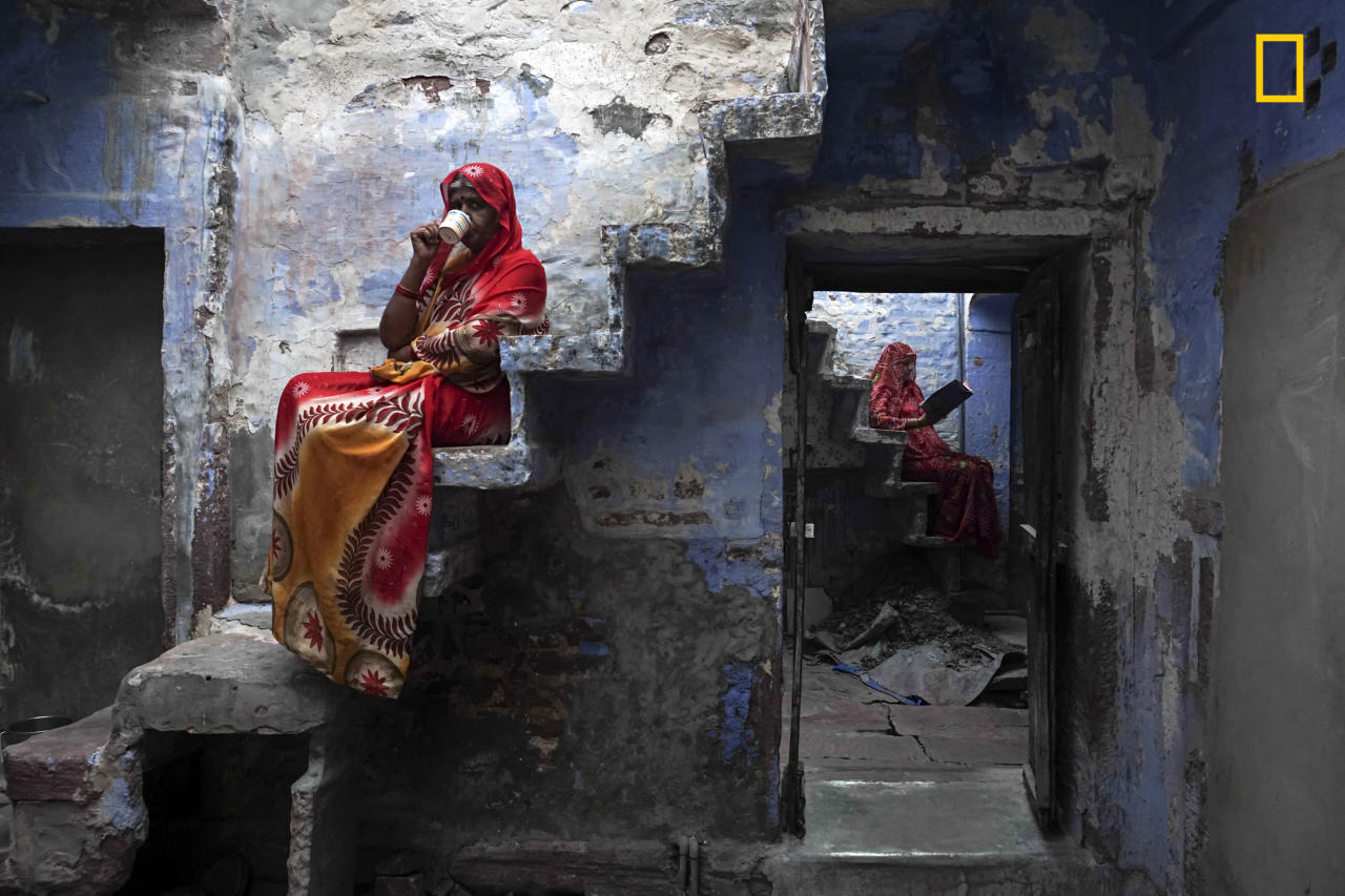 "<p>""These Rajasthani sisters were sitting on the staircase inside their house relaxing and enjoy a cup of masala chai."" (© Firdaus Hadzri/National Geographic Travel Photographer of the Year Contest) </p>"