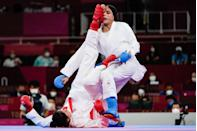 <p>Gong Li (red) of China competes against Feryal Abdelaziz of Egypt during the women's karate kumite elimination round contest.</p>
