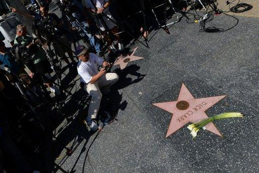 Flowers are placed on Dick Clark's Hollywood Walk of Fame Star