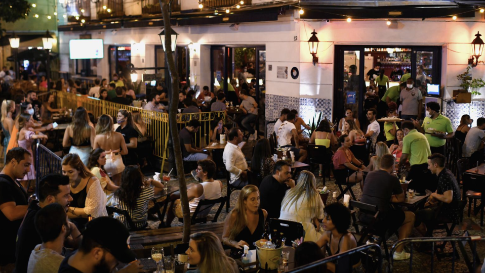 Crowd of Brazilians at a restaurant.
