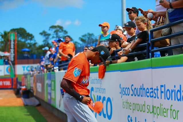 <p>Miami Marlins player Yadiel Rivera signs for fans before the baseball game against the New York Mets at First Data Field in Port St. Lucie, Fla., Feb. 25, 2018. (Photo: Gordon Donovan/Yahoo News) </p>