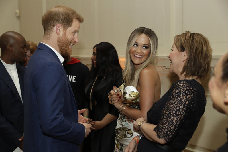 Prince Harry, Duke of Sussex speaks to British singer Rita Ora and her mum Vera Sahatciu during a reception before The Sentebale Audi Concert at Hampton Court Palace on June 11, 2019 in London, United Kingdom. (Photo by Matt Dunham – WPA Pool/Getty Images)
