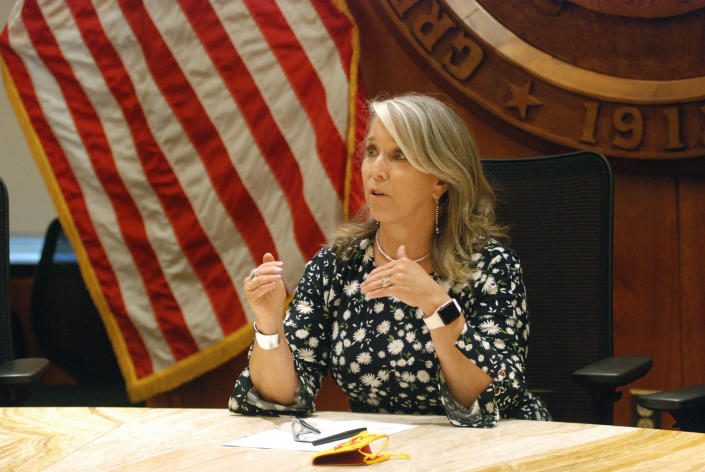 FILE — In this July 29, 2021, file photo New Mexico Gov. Michelle Lujan Grisham speaks at a news conference in Santa Fe, N.M. The governor signed an executive order Wednesday, Aug. 25, 2021, making New Mexico the latest western state to join an ambitious effort to conserve nearly one-third of America's lands and waters by 2030. (AP Photo/Morgan Lee, File )