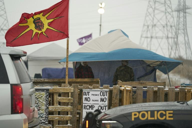 Ontario Provincial Police and First Nations protestors (pictured February 2020) sit on opposite sides of a barricade near Caledonia, Ontario that the protestors set up in support of the Wet'suwet'en hereditary chiefs and the Tyendinaga Mohawks