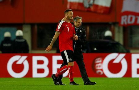 Soccer Football - 2018 World Cup Qualifications - Europe - Austria vs Serbia - Ernst Happel Stadion, Vienna, Austria - October 6, 2017 Austria coach Marcel Koller celebrates after the match with Marko Arnautovic REUTERS/Leonhard Foeger