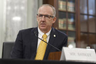 """FILE - Southeastern Conference Commissioner Greg Sankey testifies before a Senate Commerce Committee hearing on Capitol Hill in Washington, in this Wednesday, July 1, 2020, file photo. Sankey told the AP he is """"concerned — highly concerned — about the impact on all student-athletes"""" of coming changes to the way college sports finances work. A new AP survey of athletic directors and conversations with ADs and conference commissioners during March Madness show some have questions about what would happen to women's college sports under proposals that would put more money in the pockets of some athletes. (AP Photo/Susan Walsh, File)"""