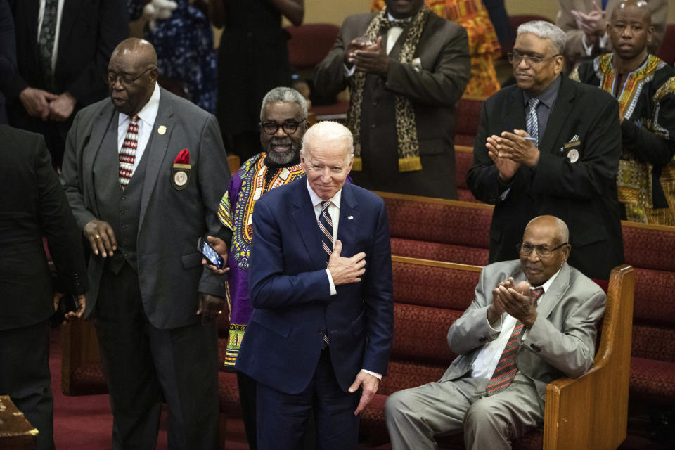 FILE - In this Feb. 23, 2020, file photo, Democratic presidential candidate and former Vice President Joe Biden acknowledges applause from parishioners as he departs after attending services at the Royal Missionary Baptist Church in North Charleston, S.C. As the candidates court devout voters with sharply divergent strategies, the unavoidable nature of presidential politics has left some clergy counseling divided families and others fielding attempts to nudge them left or right. (AP Photo/Matt Rourke, File)