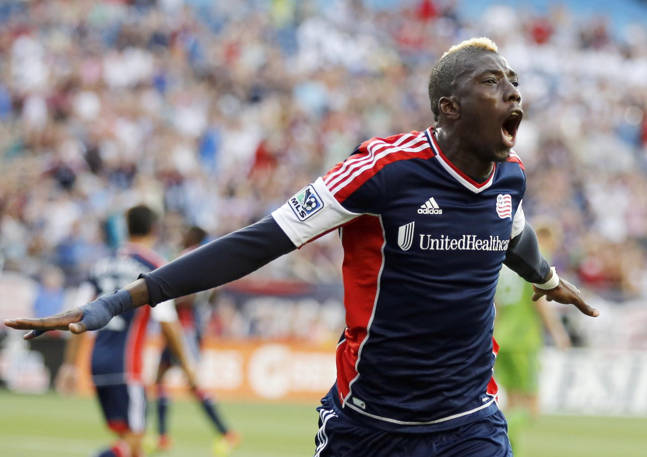 New England Revolution's Saer Sene celebrates his goal in the first half of an MLS soccer game against the Seattle Sounders in Foxborough, Mass., Saturday, June 30, 2012. (AP Photo/Michael Dwyer)