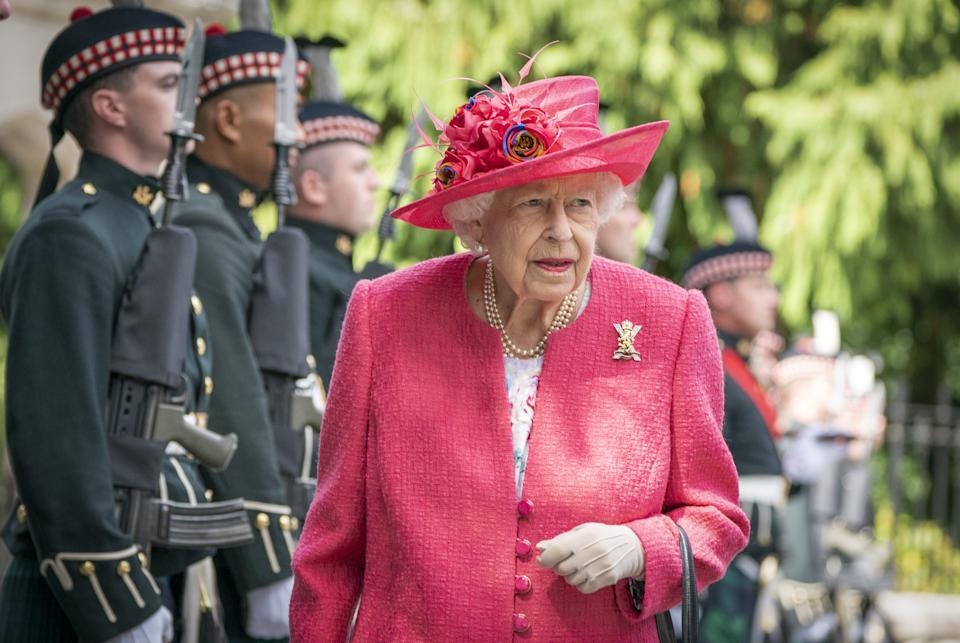 Queen Elizabeth II during an inspection of the Balaklava Company, 5 Battalion The Royal Regiment of Scotland at the gates at Balmoral, as she takes up summer residence at the castle. Picture date: Monday August 9, 2021.