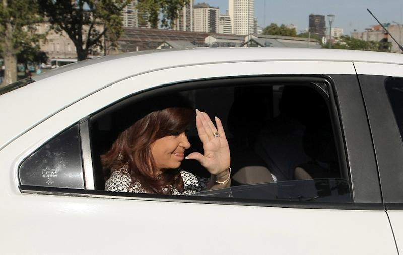 Picture released by Telam showing former Argentine president Cristina Fernandez de Kirchner arriving at the Comodoro Py court in Buenos Aires to testify in a case for alleged acts of corruption with real estate businesses in the family March 7, 2017 (AFP Photo/Gustavo Amarelle)