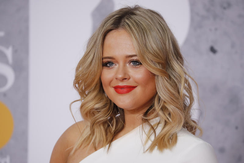 British actor Emily Atack poses on the red carpet on arrival for the BRIT Awards 2019 in London on February 20, 2019. (Photo by Tolga AKMEN / AFP) / RESTRICTED TO EDITORIAL USE NO POSTERS NO MERCHANDISE NO USE IN PUBLICATIONS DEVOTED TO ARTISTS (Photo credit should read TOLGA AKMEN/AFP via Getty Images)
