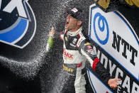Rinus VeeKay of The Netherlands celebrates after wining the IndyCar auto race at Indianapolis Motor Speedway in Indianapolis, Saturday, May 15, 2021. (AP Photo/Michael Conroy)