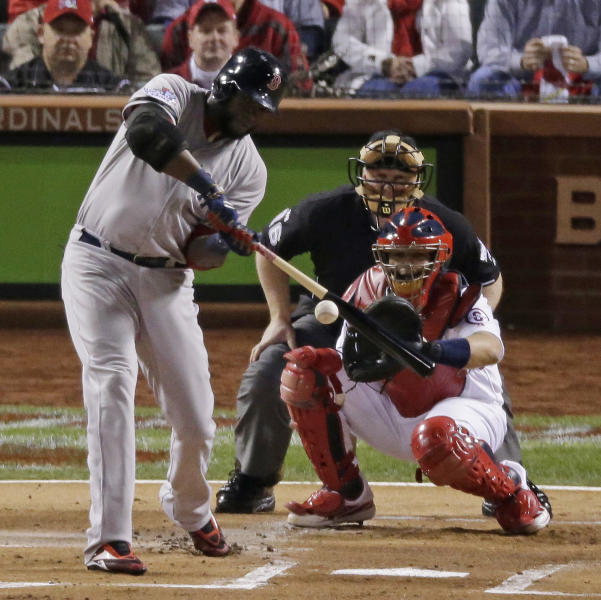 Boston Red Sox's David Ortiz hits an RBI double during the first inning of Game 5 of baseball's World Series against the St. Louis Cardinals Monday, Oct. 28, 2013, in St. Louis. (AP Photo/Charlie Riedel)