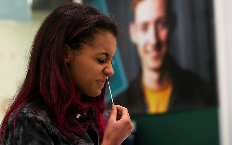 student of Newcastle Sixth Form College performs a lateral flow antigen test - LEE SMITH/Reuters
