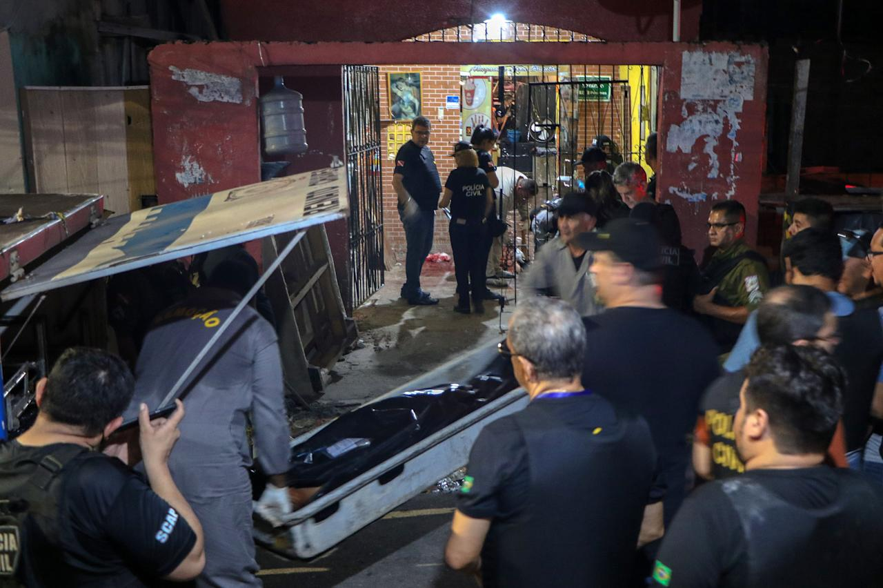 Forensic personnel and criminal police remove corpses from a bar in Belem, Para state, Brazil on May 19, 2019. (Photo: Claudio Pinheiro/AFP/Getty Images)