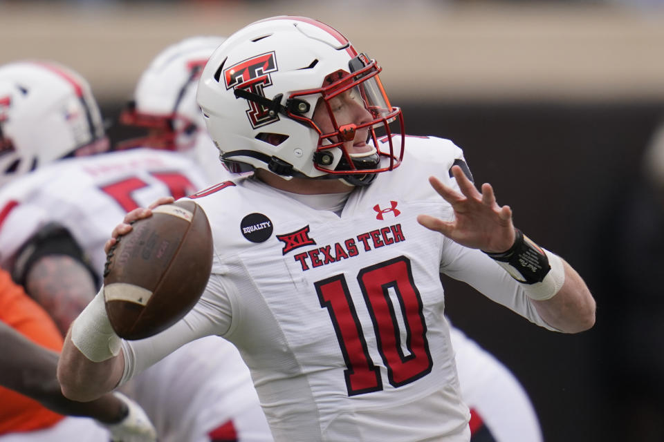 Texas Tech quarterback Alan Bowman (10) throws in the first half of an NCAA college football game against Oklahoma State in Stillwater, Okla., Saturday, Nov. 28, 2020. (AP Photo/Sue Ogrocki)