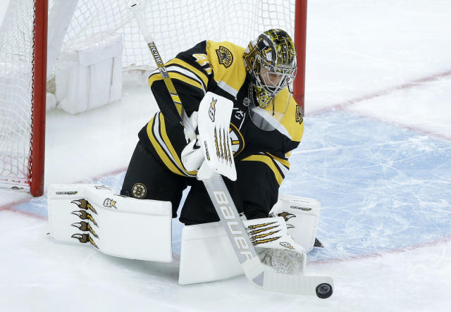 Boston Bruins' Jaroslav Halak, of Slovakia (41) deflects an attempt on goal during the first period of an NHL hockey game against the Colorado Avalanche, Sunday, Feb. 10, 2019, in Boston. (AP Photo/Steven Senne)