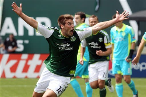 Portland Timbers' David Horst (12) celebrates after scoring in the first half during an MLS soccer game with the Seattle Sounders, Sunday, June 24, 2012, in Portland, Ore. (AP Photo/Rick Bowmer)