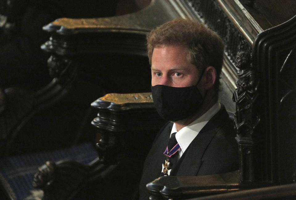 Prince Harry sits alone at St. George's Chapel during the funeral for Prince Philip, at Windsor Castle, Windsor, England, Saturday April 17, 2021. Prince Philip died April 9 at the age of 99 after 73 years of marriage to Britain's Queen Elizabeth II. (Yui Mok/Pool via AP)