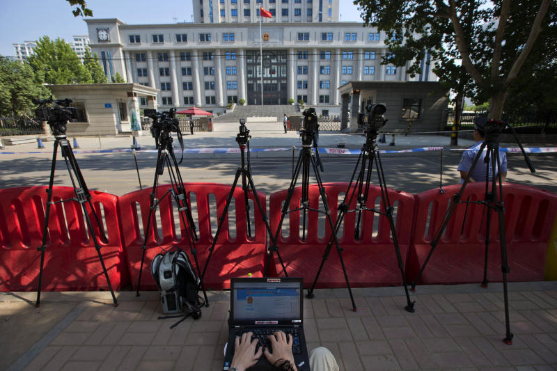 FILE - In this file photo taken Monday, Aug. 26, 2013, a journalist monitors a blog providing details of the trial of former politician Bo Xilai outside the Jinan Intermediate People's Court in Jinan in eastern China's Shandong province. The Jinan Intermediate Court released a surprising amount of details from Bo's trial, issuing regular microblog posts and same-day transcripts that included testimony, cross-examination, details of evidence and defense statements. But the partial openness is less a sign of legal reform than of the leadership's desire to lend credibility to a process believed to have a foregone conclusion: a lengthy jail sentence for Bo for dragging the ruling Communist Party into a lurid scandal of corruption, murder and betrayal. (AP Photo/Ng Han Guan, File)