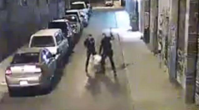 The video shows the two officers beating the man with their fists and weapons. Photo: Screenshot