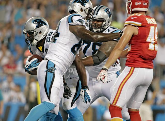 Carolina Panthers' Jonathan Stewart (28) runs into the end zone for a touchdown as Kansas City Chiefs' Daniel Sorensen (49) looks on during the first half of a preseason NFL football game in Charlotte, N.C., Sunday, Aug. 17, 2014. (AP Photo/Bob Leverone)
