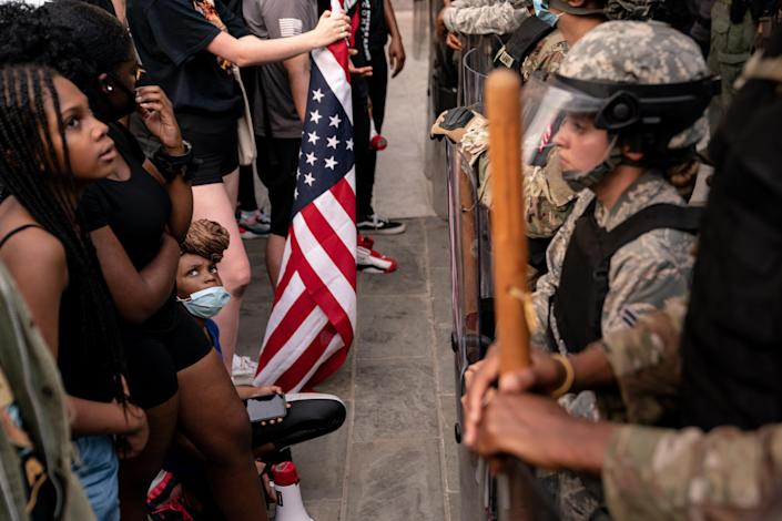 Protestors and members of the National Guard near the White House in Washington, June 3, 2020. (Erin Schaff/The New York Times)