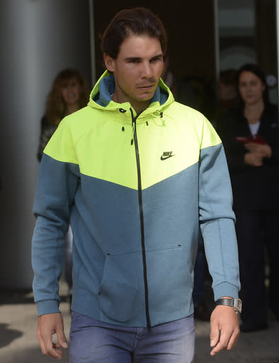 Spanish tennis player Rafael Nadal leaves the hospital after successfully undergoing an operation to remove his appendix in Barcelona, Spain, Wednesday, Nov 5, 2014. A month ago, the tennis star tried to play through suspected appendicitis at the Shanghai Masters but acknowledged experiencing discomfort and was ousted in the second round by fellow Spaniard Feliciano Lopez. Nadal tried to treat his appendix with antibiotics before opting for an appendectomy. Nadal's appendix was removed on Monday using laparoscopy or key-hole surgery, a statement said. (AP Photo/Manu Fernandez)