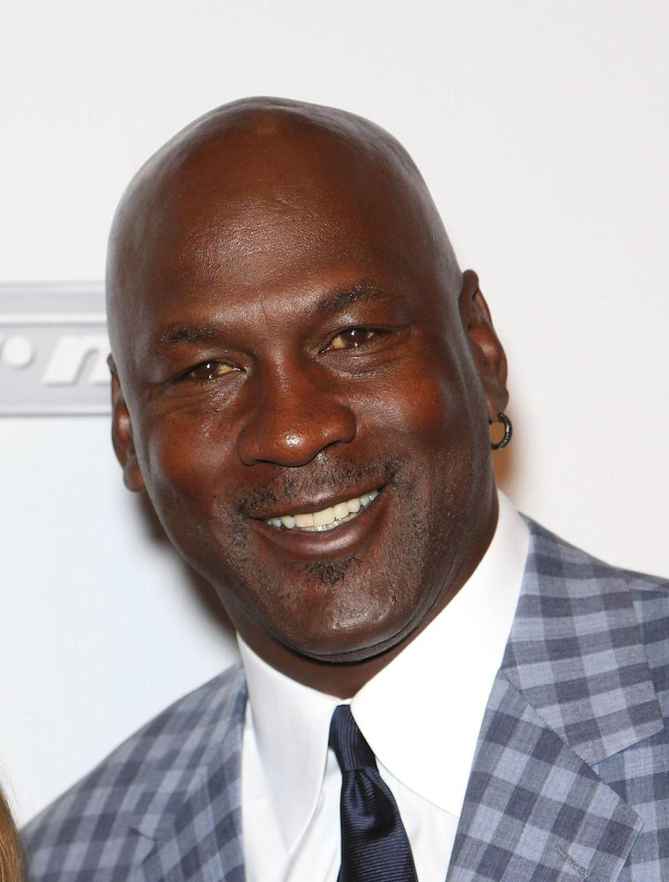 "<p>Michael Jordan has been rocking a single gold hoop earring since the '90s. Although Jordan may have <a href=""https://www.espn.co.uk/nba/story/_/id/29470986/michael-jordan-changed-fashion-game-one-beret-gold-hoop"" rel=""nofollow noopener"" target=""_blank"" data-ylk=""slk:ditched the baggy suits"" class=""link rapid-noclick-resp"">ditched the baggy suits</a> that he originally paired with his ear accessory, this piece of jewelry is still dangling from the retired NBA player's lobe. </p>"
