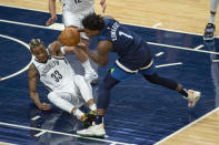 Minnesota Timberwolves guard Anthony Edwards (1) and Brooklyn Nets forward Nicolas Claxton (33) battle for a loose ball during the first half of an NBA basketball game Tuesday, April 13, 2021, in Minneapolis. (AP Photo/Craig Lassig)