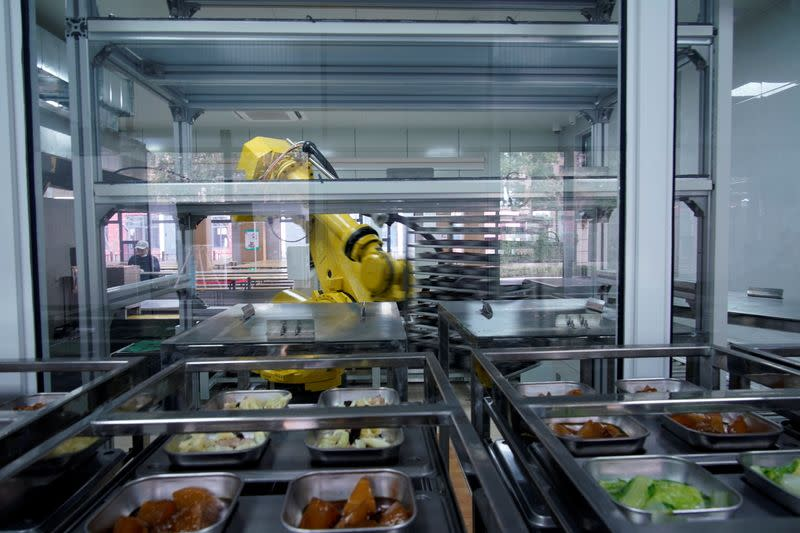 A robot chef makes food for lunch at Minhang Experimental High School amid the global outbreak of the coronavirus disease (COVID-19) in Shanghai