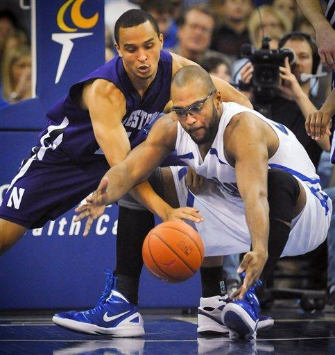 Northwestern's Reggie Hearn (11) and Creighton's Gregory Echenique (00) go for a loose ball during an NCAA college basketball game in Omaha, Neb., Thursday, Dec. 22, 2011. (AP Photo/Dave Weaver)