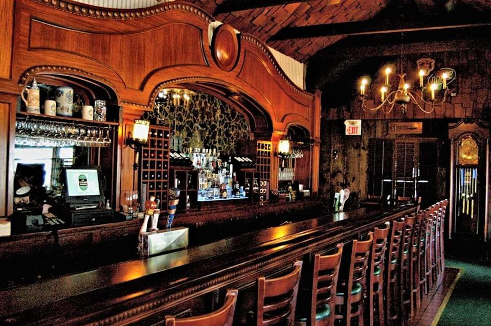 """<p>You can't help but belly up to the 35-foot mahogany bar at this <a href=""""https://go.redirectingat.com?id=74968X1596630&url=https%3A%2F%2Fwww.tripadvisor.com%2FRestaurant_Review-g36282-d2394984-Reviews-The_Village_Tavern-Long_Grove_Lake_County_Illinois.html&sref=https%3A%2F%2Fwww.redbookmag.com%2Ffood-recipes%2Fg34142495%2Foldest-restaurants-america%2F"""" rel=""""nofollow noopener"""" target=""""_blank"""" data-ylk=""""slk:Long Grove tavern"""" class=""""link rapid-noclick-resp"""">Long Grove tavern</a>. It's been in operation since 1849, and people still love it for the live entertainment and specials like prime rib and an all-you-can-eat fish fry.</p>"""