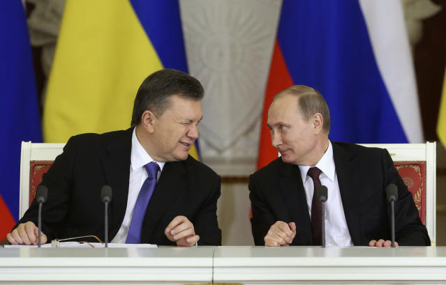 Then Ukrainian President Viktor Yanukovich, left, gives a wink to his Russian counterpart Vladimir Putin during a signing ceremony after a meeting of the Russian-Ukrainian Interstate Commission at the Kremlin, Dec. 17, 2013. (Photo: Sergei Karpukhin/Reuters)
