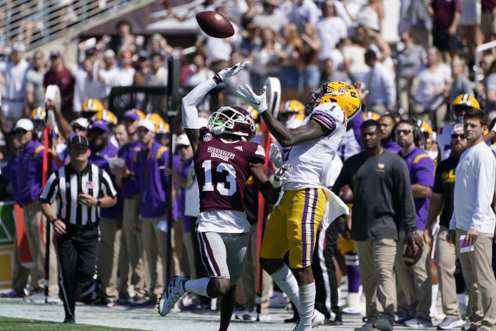 Mississippi State cornerback Emmanuel Forbes (13) knocks away a pass intended for LSU wide receiver Kayshon Boutte (1) during the first half of an NCAA college football game, Saturday, Sept. 25, 2021, in Starkville, Miss. LSU won 28-25. (AP Photo/Rogelio V. Solis)