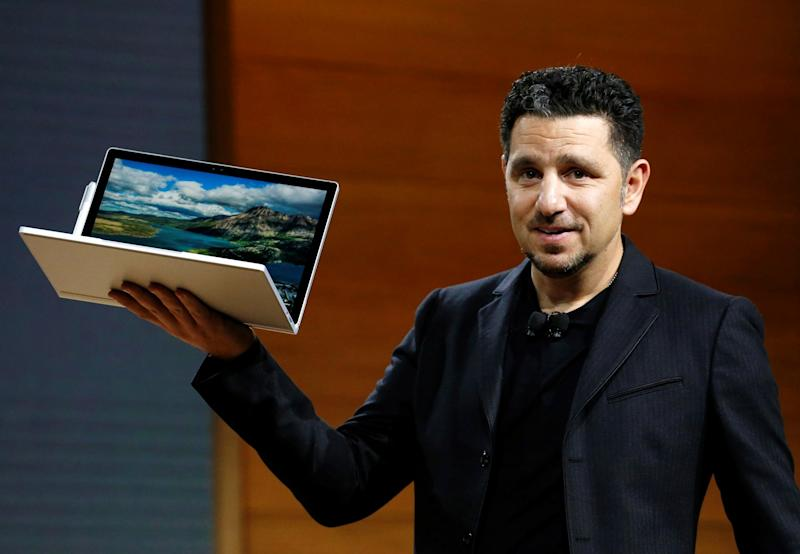 Panos Panay, Corporate Vice President for Surface Computing holds the new Microsoft Surface Book i7 laptop. REUTERS/Lucas Jackson