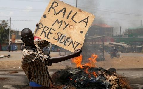 Supporter of Kenyan opposition leader Raila Odinga have pledged to take to the streets  - Credit: Reuters
