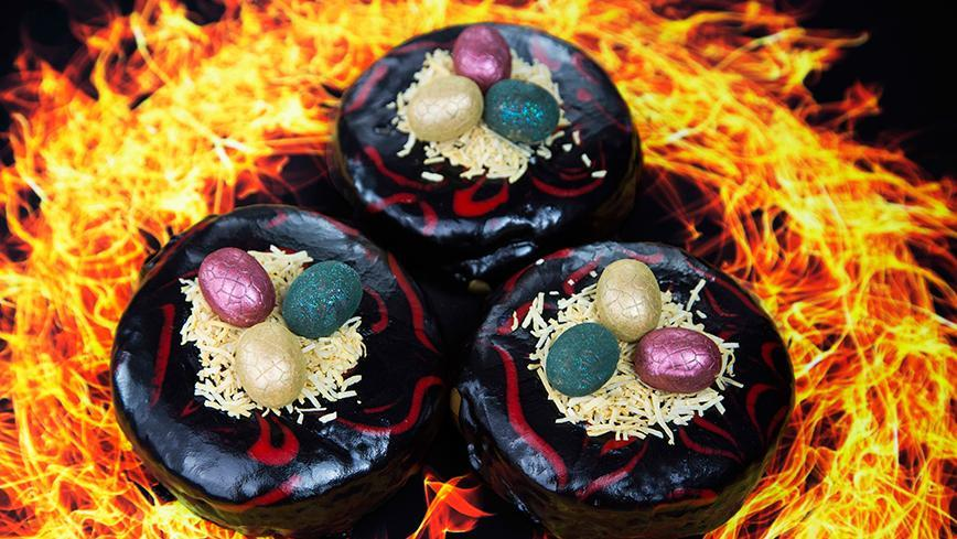 <p>If you're a fan of Game of Thrones, you'll love these limited edition Doughnut Time glazed treats. The red and black delights are topped with a crispy coconut nest and a replica of Khaleesi's dragon eggs. They're only available from July 14th to 20th though so you better be quick.</p>
