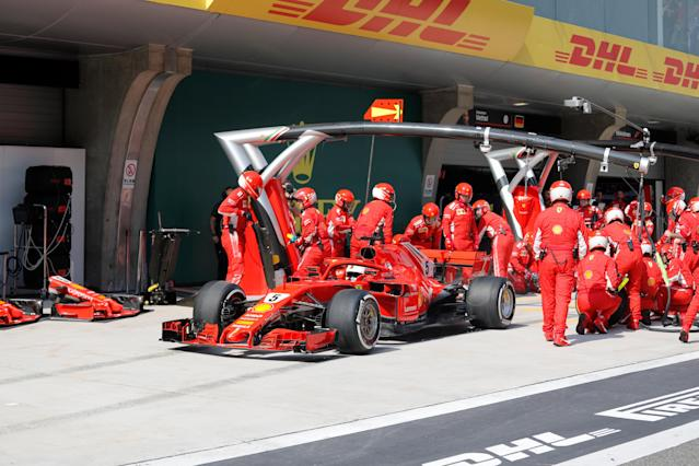 Formula One - F1 - Chinese Grand Prix - Shanghai, China - April 15, 2018 - Ferrari driver Sebastian Vettel of Germany speeds off from the pit stop during the race. Pool via REUTERS