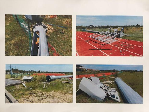 Photos showing damages to the track-and-field sports complex.
